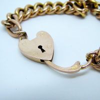 Gold Charm Bracelet with Heart Lock