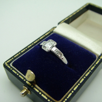 Emerald Cut Centre Stone Diamond Ring with Rub-over Setting