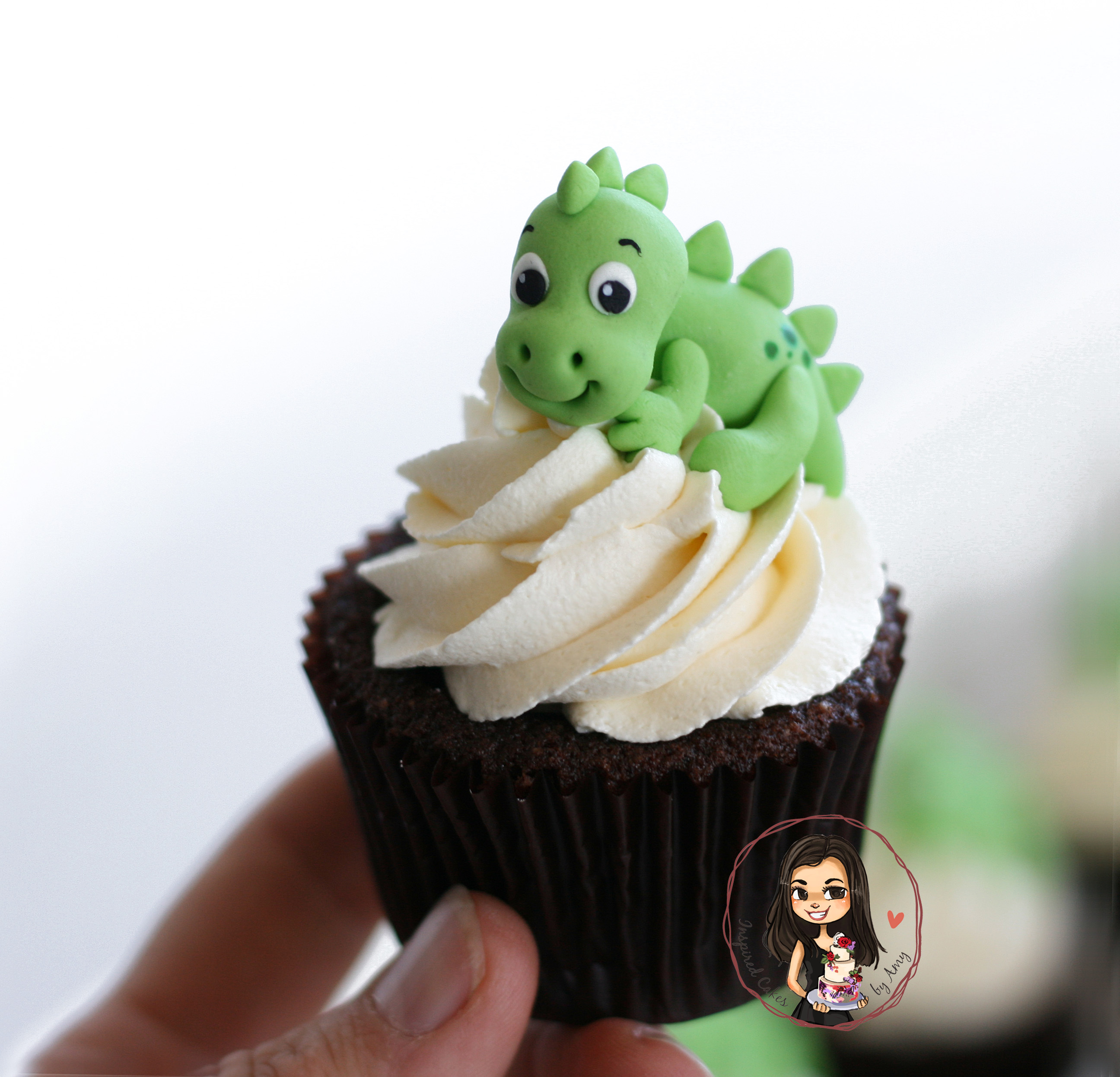 Baby Dinosaur hugging a cupcake - Inspired Cakes by Amy
