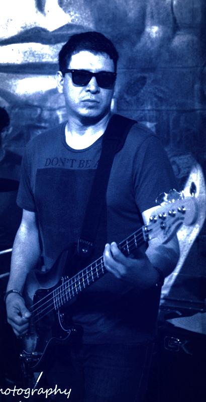 "Exit Left's Bass Guitarist ""Edmax"""