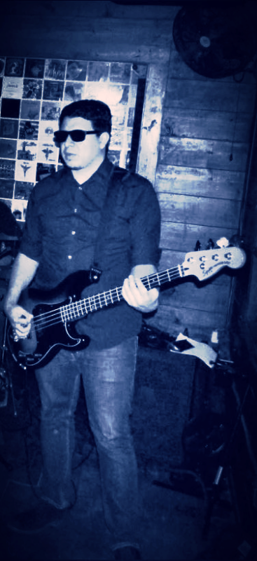 "Exit Left's Bass Guitarist ""Edmax"""