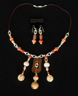Bone, jasper and pewter beads with buffalo hone centerpiece. $75.00 set
