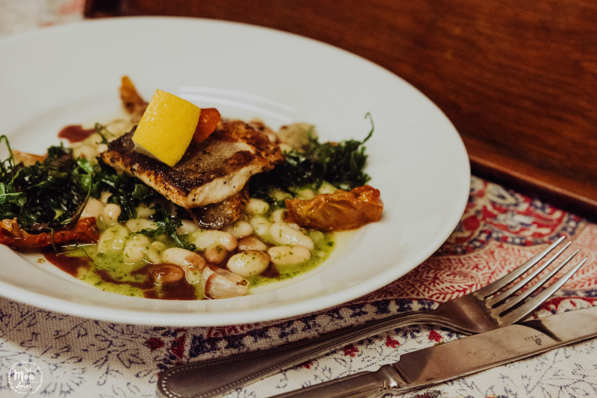 sea bass with white bean salad and roast garlic
