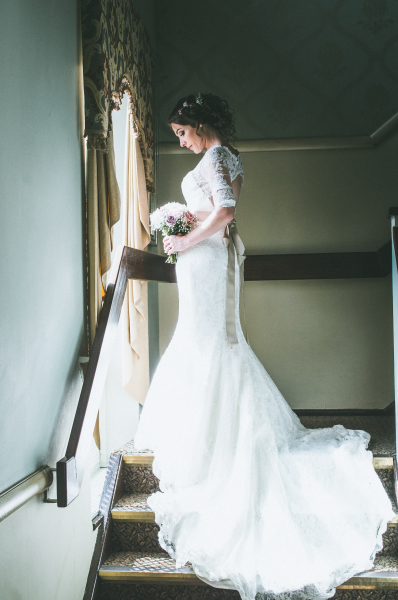 "<alt=""artistic wedding photography bride on stairs"">"