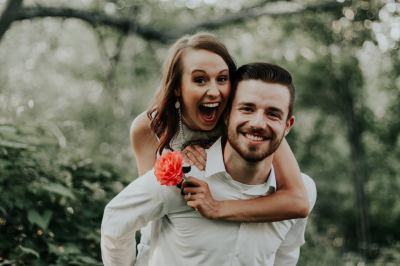 Young couple smile while celebrating special moment of happiness