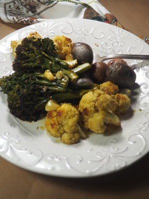 roasted veggies and potatoes with pumpkin oil