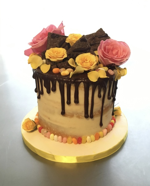 custom cakes nj chocolate drip cake with yellow candy