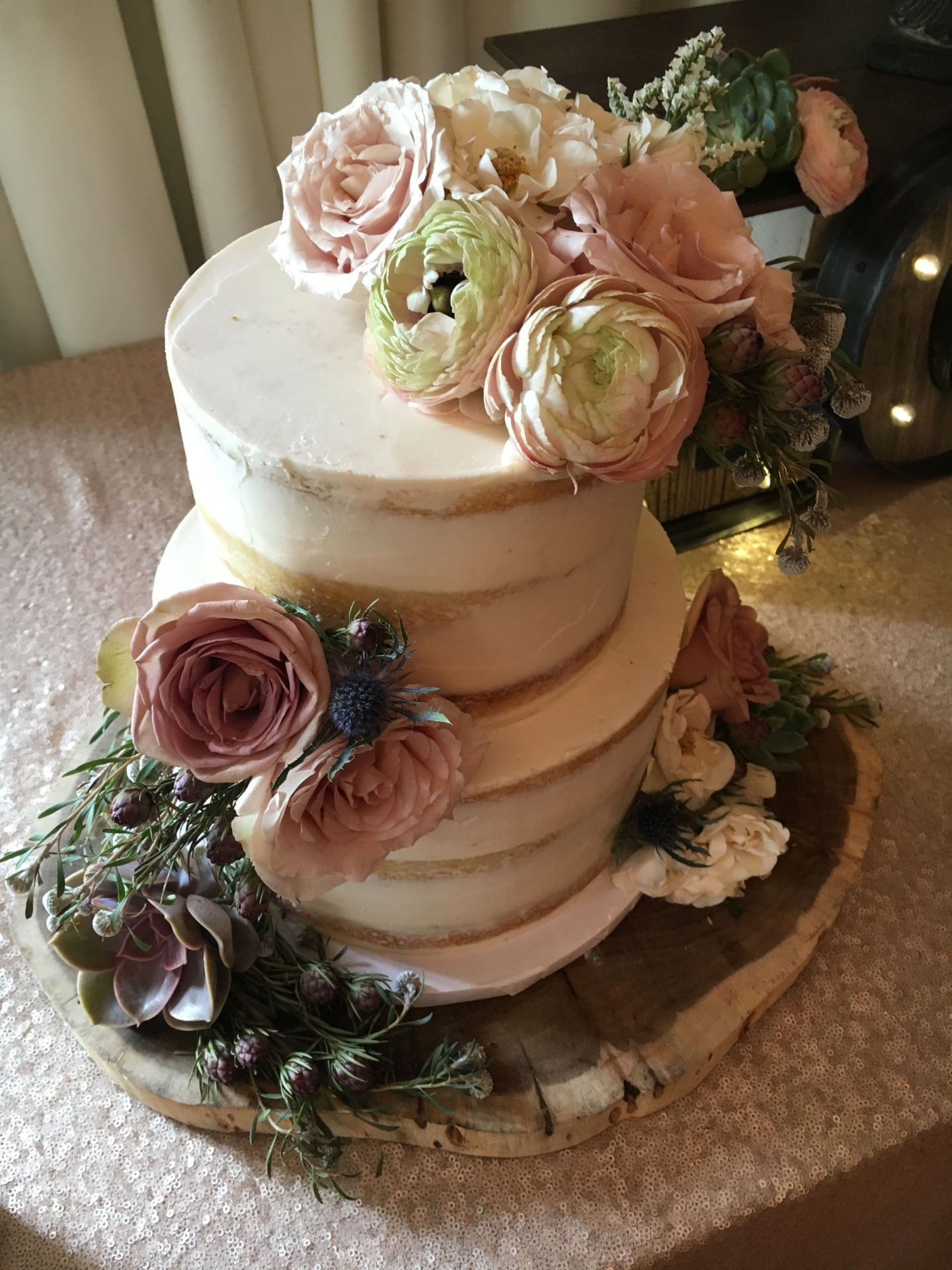 rustic Wedding cake semi naked with fresh flowers