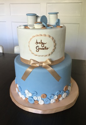 button themed baby shower cake