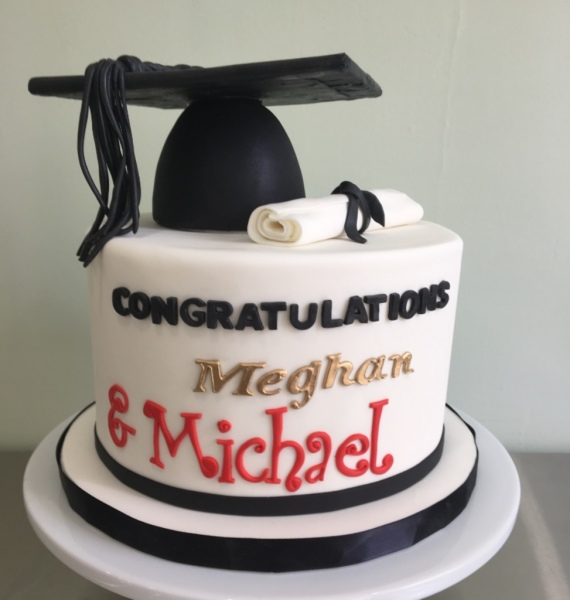 Black, white and gold graduation cake