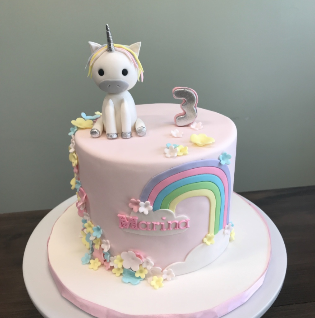 custom cakes NJ Pink cake with rainbow and fondant unicorn on top