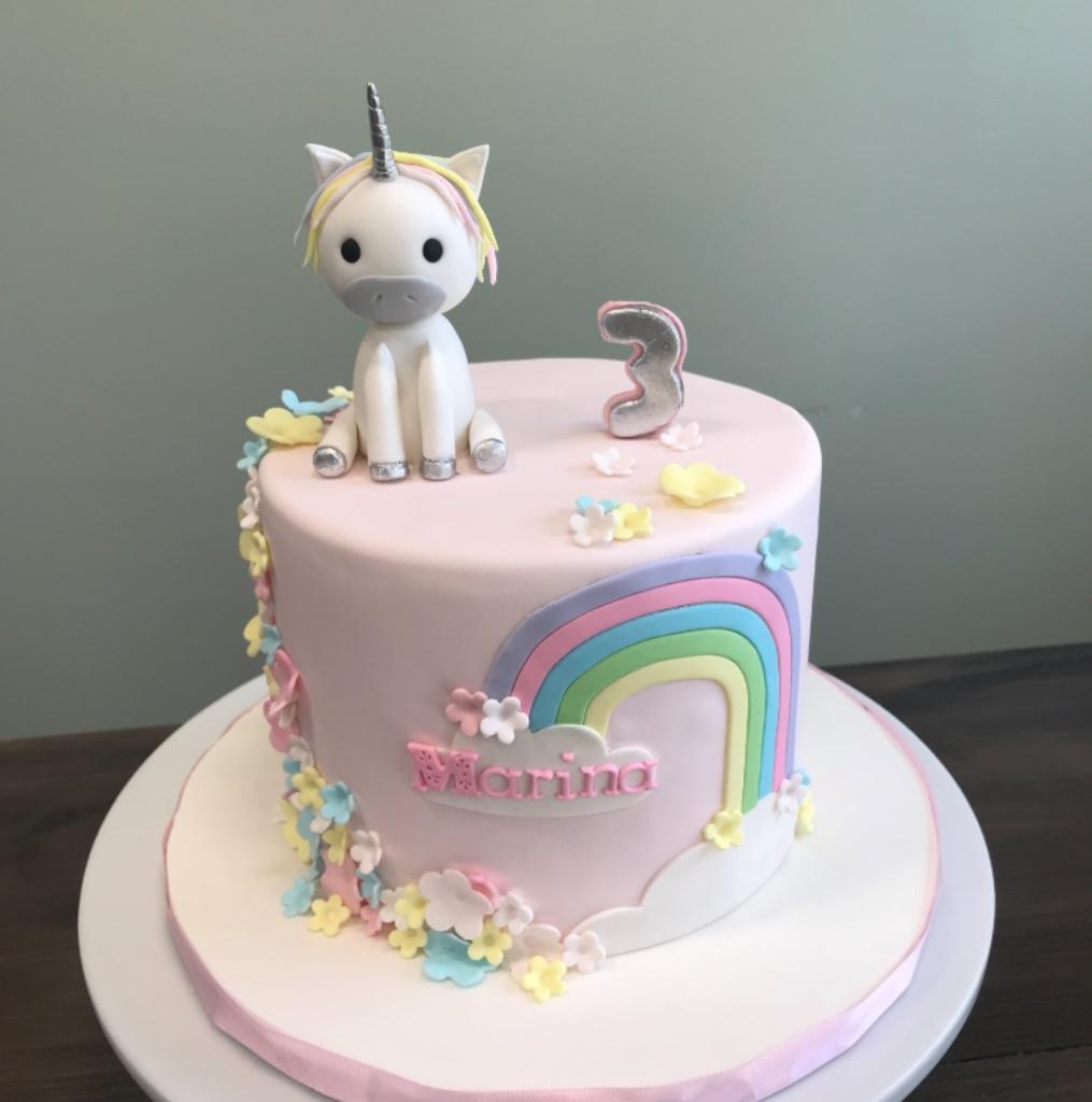 custom cakes NJ Pink cake with rainbow and fondant unicorn on top