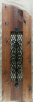 arched decorative cedar & iron shutter / accent