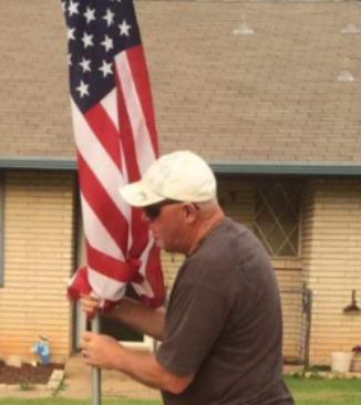 Putting flags out for Midwest City Rotary Club