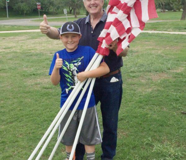 AJ helping pick up flags for the exchange club
