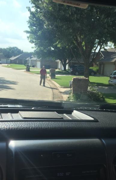 Roger walking door to door handing out brochures