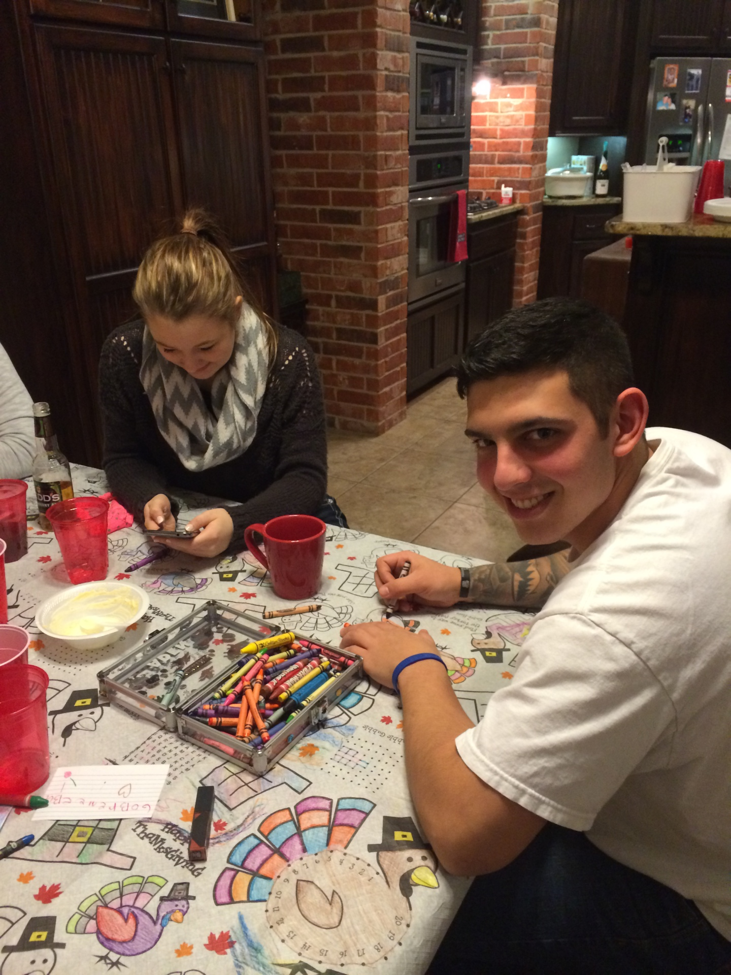 Airmen coloring at children's table on Thanksgiving