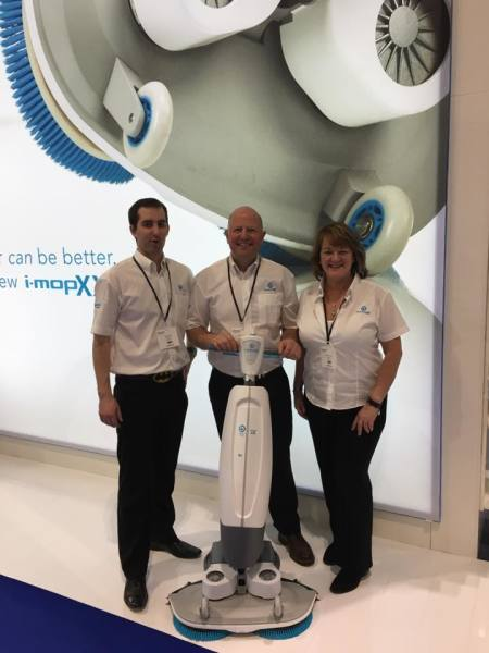 Peter, Kevin and Mandy standing with the i-mop