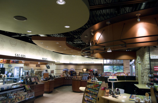 Popular convenience store retrofitted lighting with efficient LED types to improve merchandising and lower operating costs