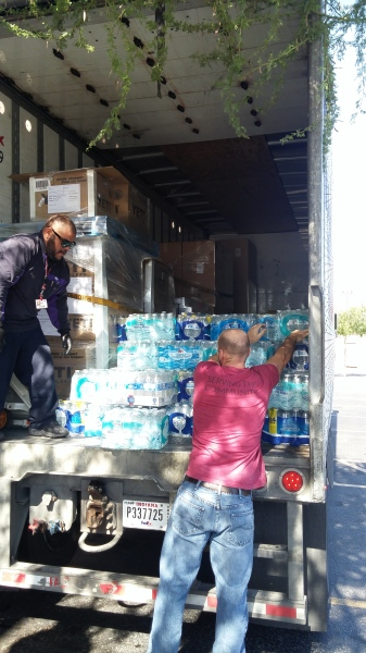 Working with other local businesses to collect water for the Phoenix Rescue Mission