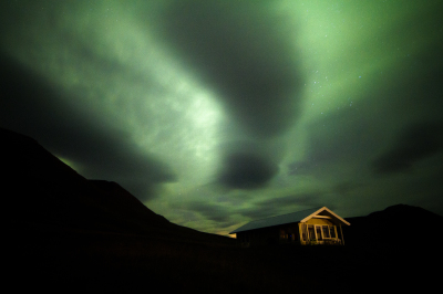 Dark northern lights and the yellow cottage