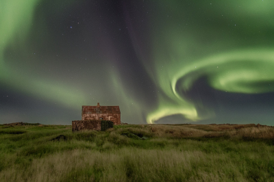 Northern lights and abandoned house