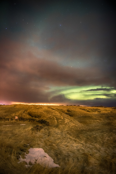 Northern lights breaking through