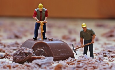 toy construction workers chopping chocolate