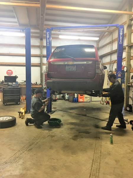 Our technicians finishing up a rear brake job