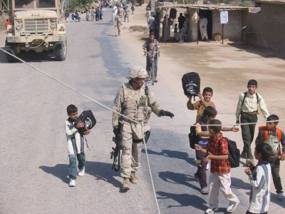 Iraq 2005 giving backpacks to kids