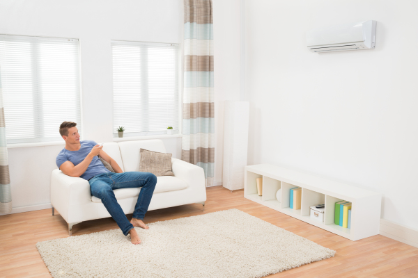 """alt=""""Man using air conditioner installed be renew air"""">""""."""