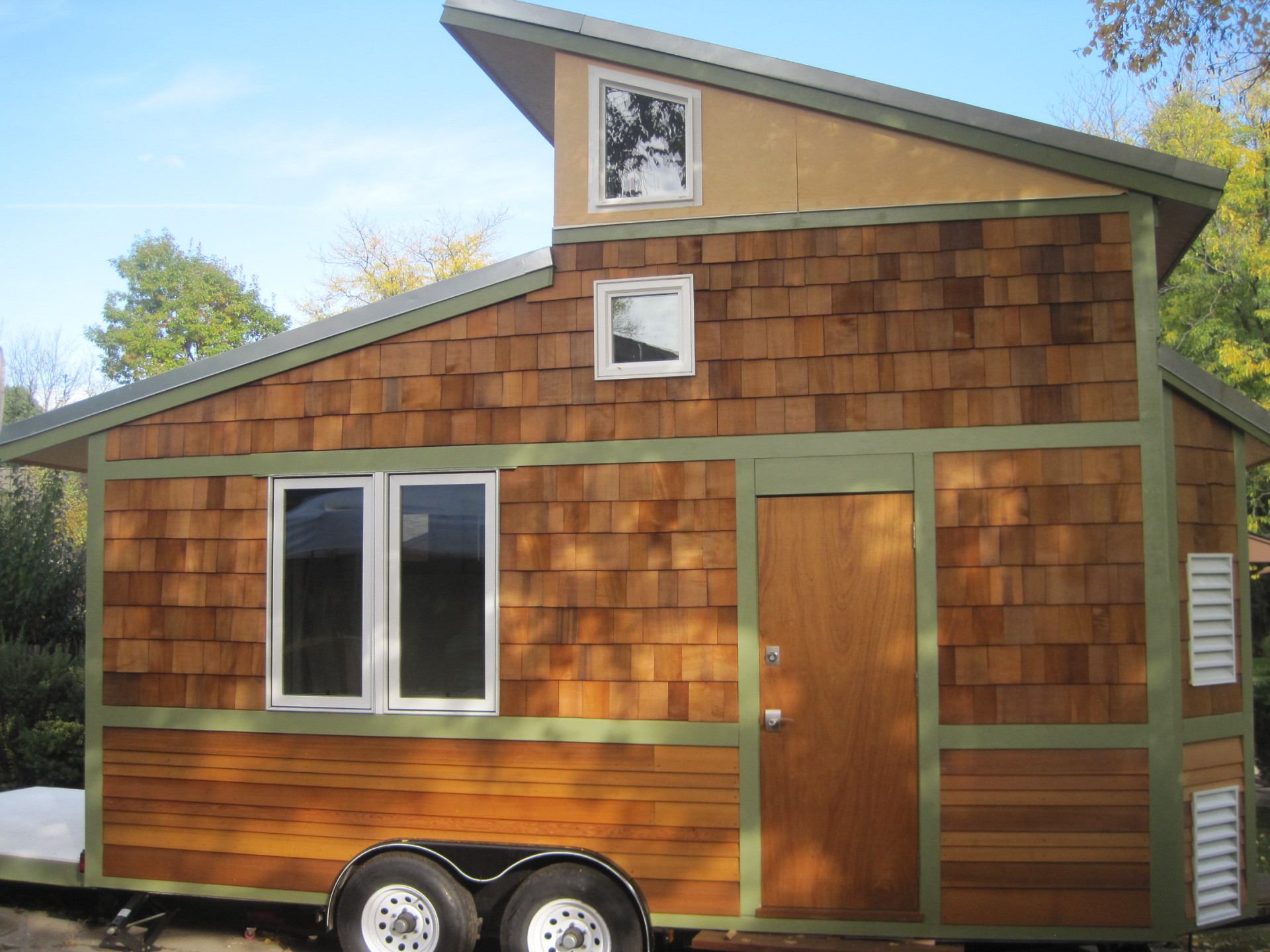 Image of the tiny house know as the Band Wagon. View of the Side Door an Windows