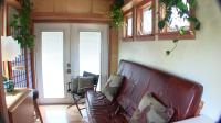 """Inside View of Tiny House"" ""Showing Couch and French Doors"""