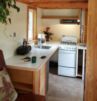 """Kitchen View of Tiny House"" ""Showing Stove, Counter, and Sink"""