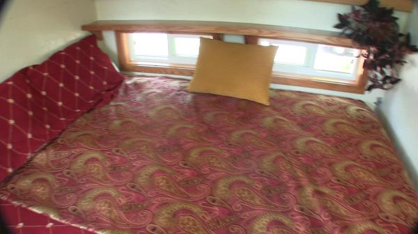 Full Size Bed in the Loft all made up with blanket and pillows