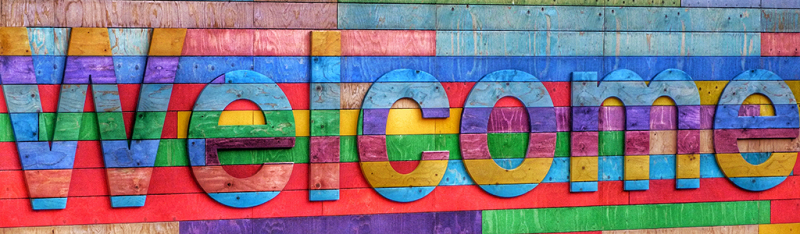 colorful wooden welcome sign