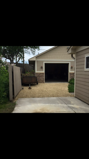 new graded lime rock driveway back to homeowners shed