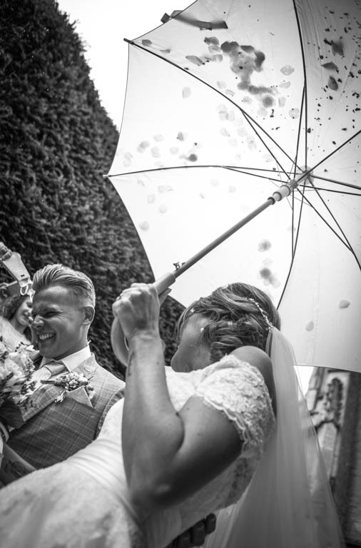 Charles McArthur Wedding Photography Wedding day umbrella for confetti Gloucestershire