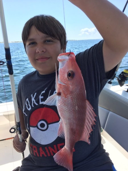 Boy with red fish