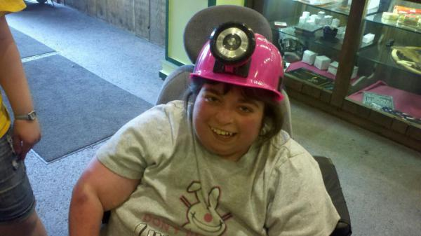 Amber trying her hand at mining with her Pink coal miner hat!
