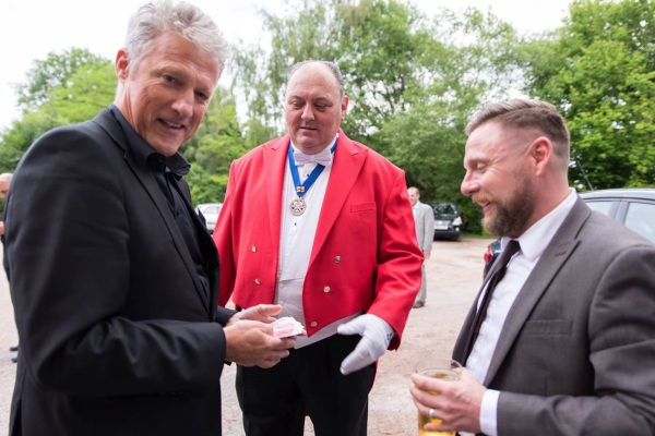 Toastmaster playing the wedding sport with wedding magician and wedding guest