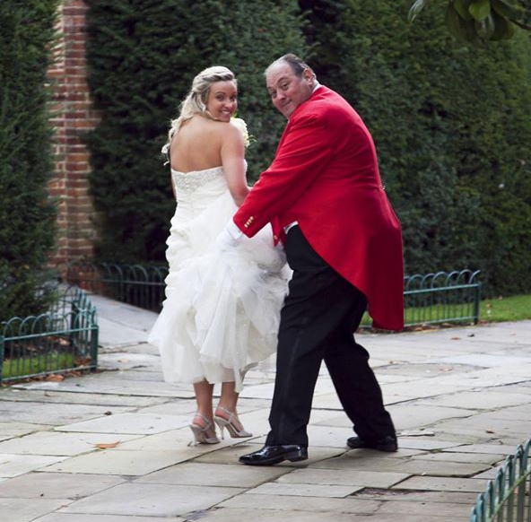 Toastmaster Nick Ede, helping the Bride with her skirts and pretending to run away with her