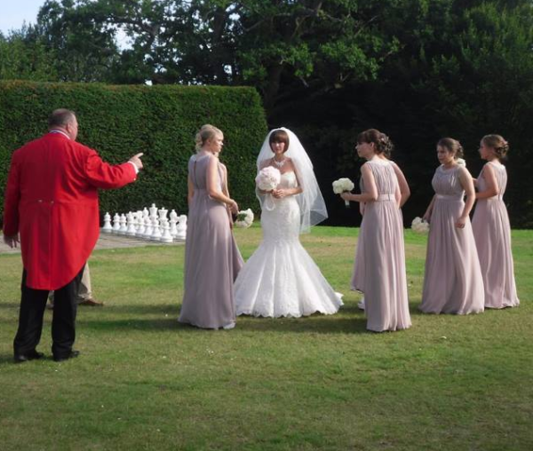 Toastmaster in command, if only Bride and Bridesmaids knew