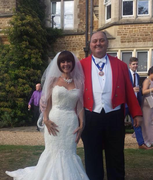 Smiling Toastmaster with beautiful Bride at Hartsfield Manor