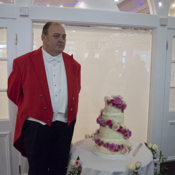 Toastmaster on duty guarding Wedding Cake at Kingswood Golf Club