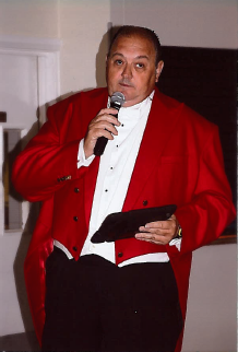 Nick Ede, Toastmaster and Master of Ceremonies doing what he does best, talking to the reception over a microphone