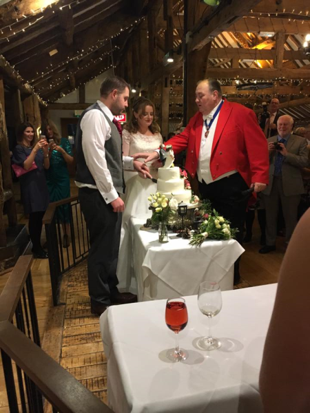 Cutting the wedding cake under the direction of the Toastmaster what could go wrong?