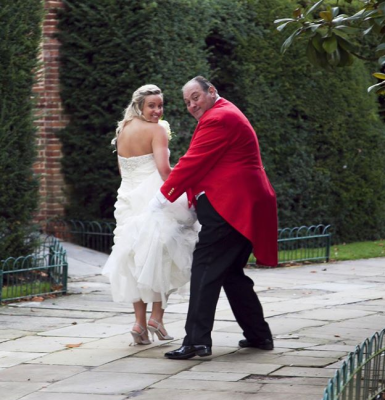Toastmaster helping Bride with her skirts and making a run for it