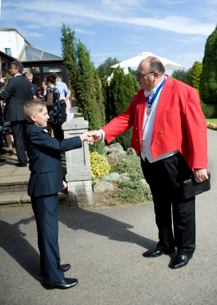 Nick Ede, Toastmaster shaking the hands of one of the Youngest Best Men he's had the pleasure to work with