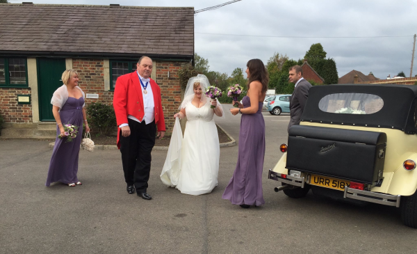 The Toastmaster is on hand to escort the Bride from her wedding car to the Reception